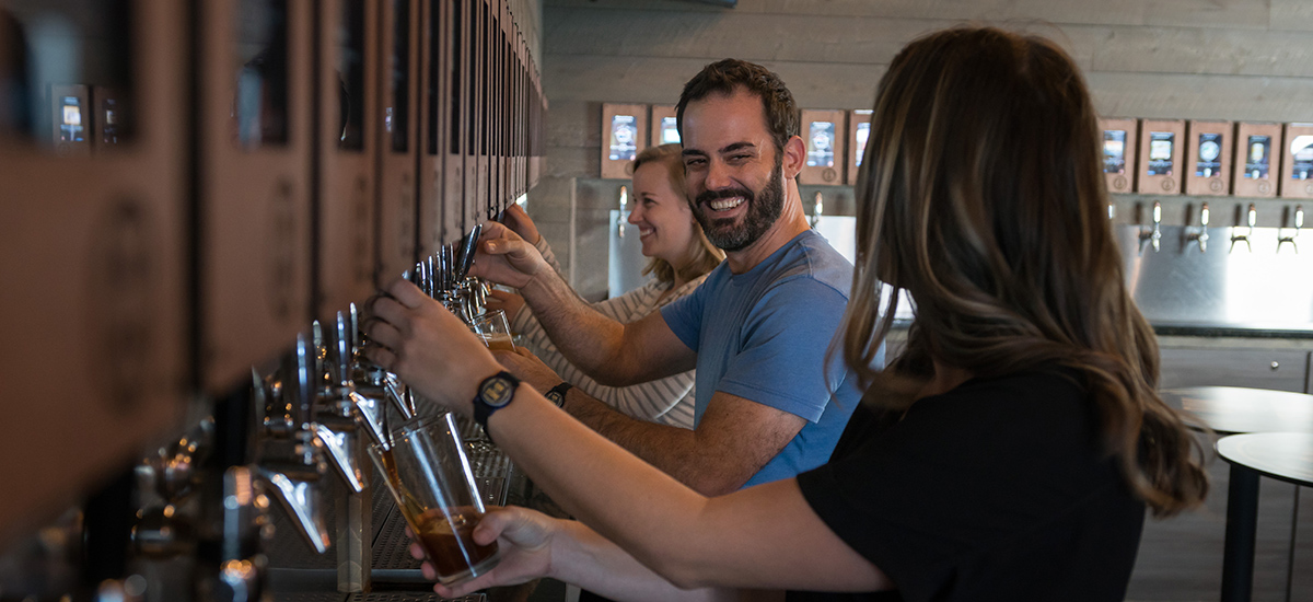 Bartenders pouring beer at oak and stone